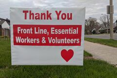 Thank you front line, essential workers & volunteers sign in front of a house during corona virus pandemic outbreak