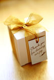 Thank you gift. A small box of appreciation/ thank you gift. Golden yellow tinted to enhance the mood. Shallow depth of field shot is intentional royalty free stock images
