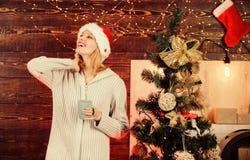 Thank you. girl drink milk. happy new 2020 year. merry christmas. xmas morning joy. woman santa hat at decorated tree