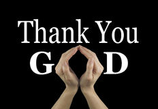 Thank You God. Female hands making an 'O' shape in the word GOD on a black background with Thank You above Royalty Free Stock Photography