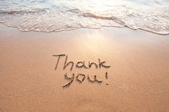 Thank you, gratitude concept. Beautiful card, word written on sand beach royalty free stock photography