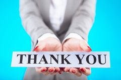Thank you. Hand of business lady showing card with thank you message Royalty Free Stock Images
