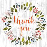 Thank you hand lettered text in calligraphic style. Vector. Stock Photography
