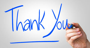 Thank You hand writing with a blue mark on a transparent board Stock Photos
