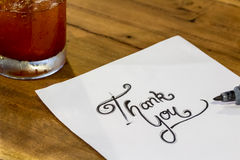 Thank you - Hand writing text on wood Stock Photo