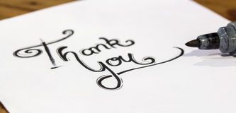 Thank you - Hand writing text on wood. Background royalty free stock images