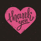 Thank you handwritten vector illustration on pink heart background Stock Image