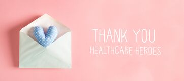 Thank You Healthcare Heroes message with a heart cushion in an envelope