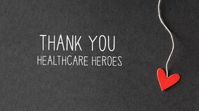 Thank You Healthcare Heroes message with paper hearts