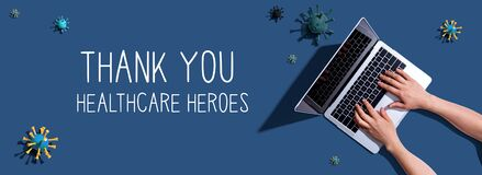 Thank You Healthcare Heroes message with woman using a laptop