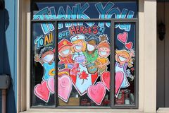 Thank you healthcare workers hearts message artwork sign on the window coronavirus quarantine