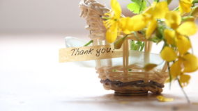 Thank you idea text and flowers. Thank you letter tag or label a basket of flowers stock video footage