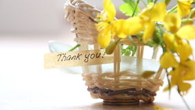 Thank you idea text and flowers. Thank you letter tag or label a basket of flowers stock video
