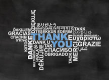 Thank you II. Thank you, thanks in different languages on blackboard Stock Image