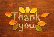 Thank you  inscription. Chalk  inscription thank you and autumn leaves Royalty Free Stock Photo