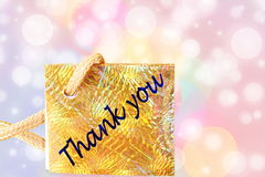 Thank you letter tag or label with de focused circles background Royalty Free Stock Images
