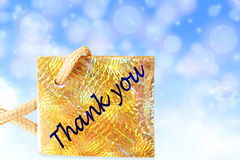Thank you letter tag or label with de focused circles blue sky background Stock Photo