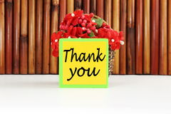 Thank you letter tag or label with flower and bamboo basket Stock Photo