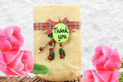 Thank you letter tag or label with flower and  jute bag Royalty Free Stock Image