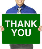 Thank You. A man holding a sign indicating Thank You Stock Image