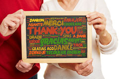 Thank You in many languages on blackboard Stock Image