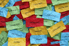 Thank you in many languages. On crumpled colorful pieces of paper Royalty Free Stock Photography