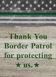 Thank You message on an American thin green line flag for border patrol agents royalty free stock image