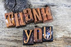 Thank you message appreciation letterpress. Thank you thanks for your help sign letterpress block letters barn wood background appreciation Royalty Free Stock Image