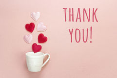 Thank you message and coffee cup with hearts coming out of it  o Stock Image