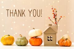 Thank you message with pumpkins with a house. Thank you message with collection of autumn pumpkins with a toy house stock photo