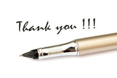 Thank you message and pen. Isolated on white royalty free stock photography