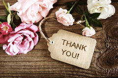 Thank You message with small roses. On wood background Royalty Free Stock Photos