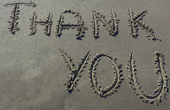 Thank you message written in sand royalty free stock image