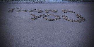 Thank you message written in sand Stock Images
