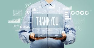 Thank you message with man holding a tablet
