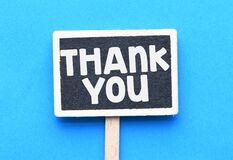 THANK YOU. Mini chalkboard with the word thank you on blue background