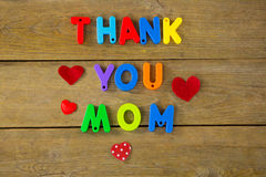 Thank you mom message with red hearts. On wooden plank royalty free stock photography