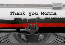 Free Thank You Momma Phrase By The Old Typewriter On White Paper Royalty Free Stock Photos - 117208858