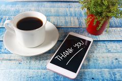Thank You, Motivational Words Quotes Concept. Thank You words letter, written on smart phone screen, work desk top view. Motivational business typography quotes royalty free stock images