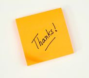 Thank you note. A note of thanks scribbled on a bright color post-it pad Stock Image