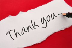 Thank you note. On red background Stock Photo