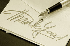 Thank you note. And pen - sepia stock image