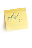 Thank you note. Yellow Post it note written with Thank you and a smiley face isolated on white with clipping path Stock Image
