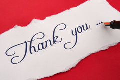 Thank you note. On red backgroune royalty free stock photo
