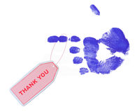 Thank you note. Pink thank you tag on blue pointed finger Stock Photos