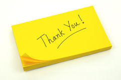 Thank you note. Note of thanks on a yellow pad Royalty Free Stock Image