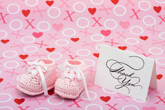 Thank You Note. A white thank you card with baby booties on a pink love background, thank you note Royalty Free Stock Images