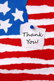 Thank You Note on American Paper Flag. A Thank You Note on an American Paper Flag Royalty Free Stock Photo