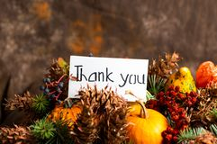 Thank you note and autumn festive symbols royalty free stock photo