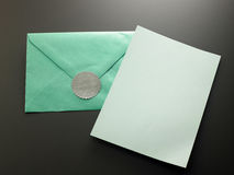 Thank you note. Blank card with the green envelope with thank you sticker royalty free stock image